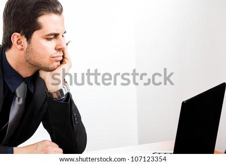 Businessman looking at a computer monitor