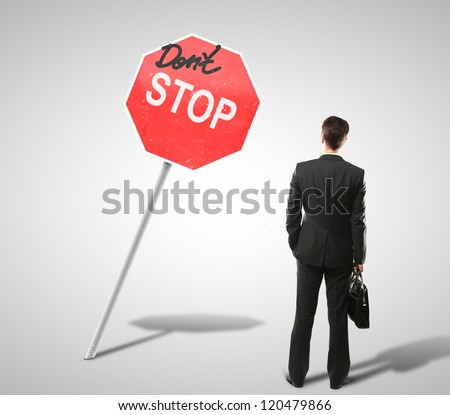 businessman looking at a stop sign