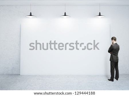 businessman looking at blank poster