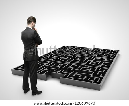businessman looking at labyrinth
