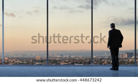 Businessman looking at Los Angeles downtown from business loft (3D Rendering) #448673242