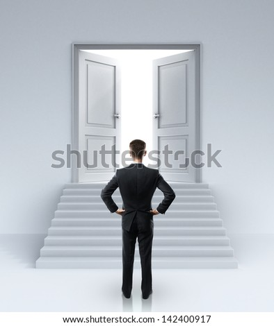 businessman looking at opened doors