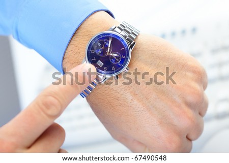 Businessman looking at the watch