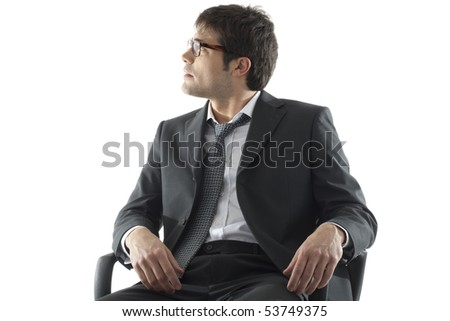 Businessman looking away, isolated on white