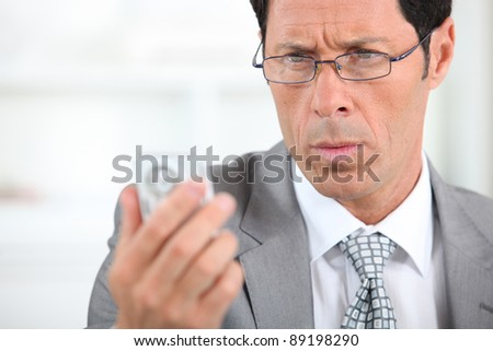 businessman looking concerned