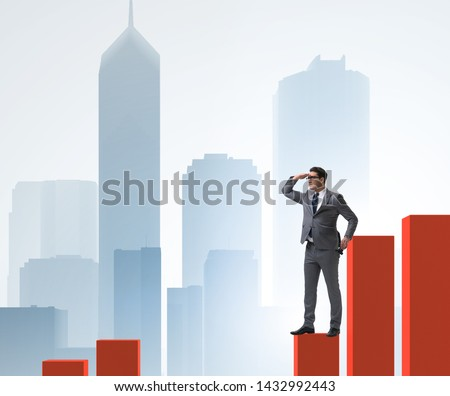 Businessman looking far in economic forecasting concept #1432992443