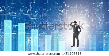 Businessman looking far in economic forecasting concept #1451903513