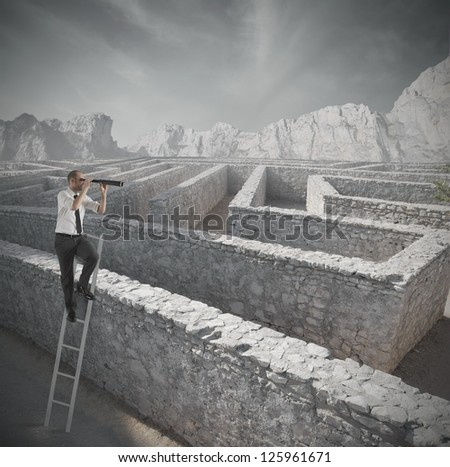 Businessman looking for the solution to the maze