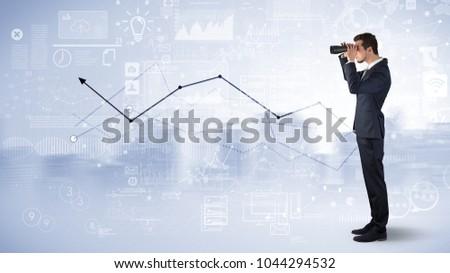 Businessman looking forward through binoculars with increase concept