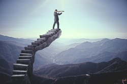 Businessman looking into the distance on abstract stairs. Landscape background. Research and vision concept