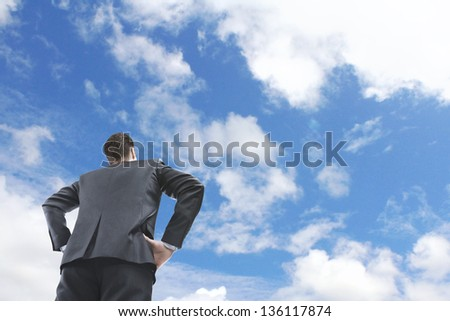 businessman looking on blue sky