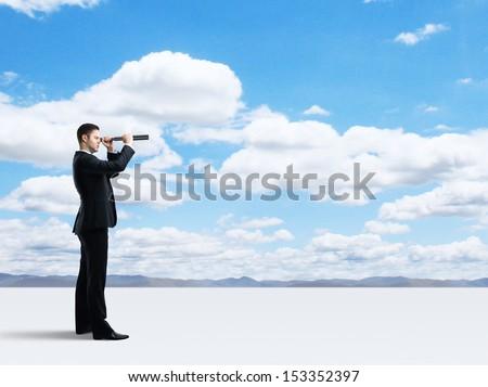 businessman looking through a telescope