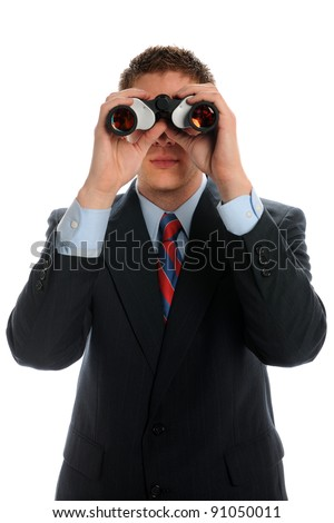 Businessman looking through binoculars for business opportunities