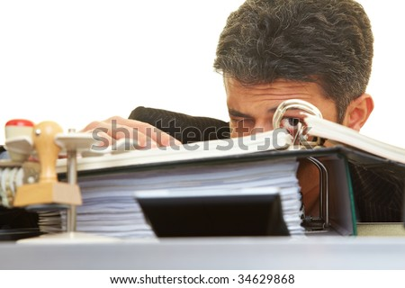 Businessman looking through files