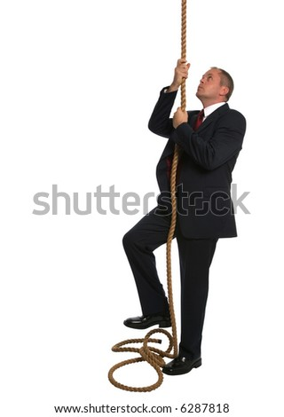 Businessman looking to climb to the top of a rope.