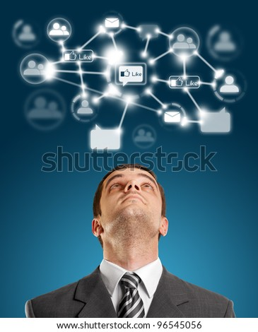 Businessman looking upwards in social network