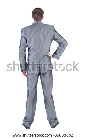 Businessman  looks ahead. rear view. Isolated over white .