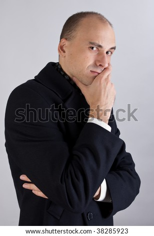 Businessman looks at the camera with a fretful expression