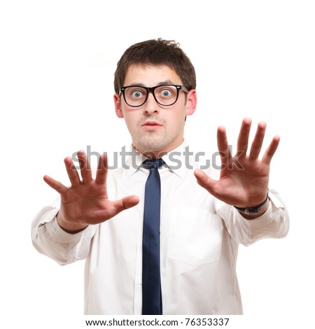 Businessman looks shocked. Isolated over white.