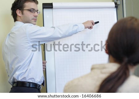 Businessman making a presentation to other employee
