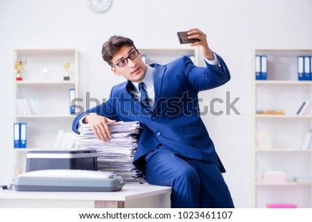 Businessman making copies in copying machine #1023461107