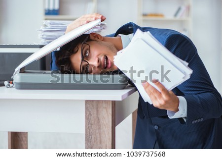Businessman making copies in copying machine #1039737568