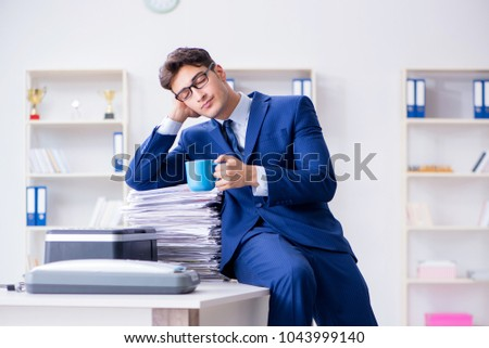 Businessman making copies in copying machine #1043999140