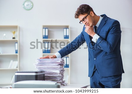Businessman making copies in copying machine #1043999215