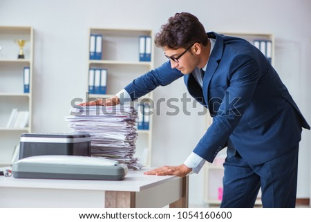 Businessman making copies in copying machine #1054160600