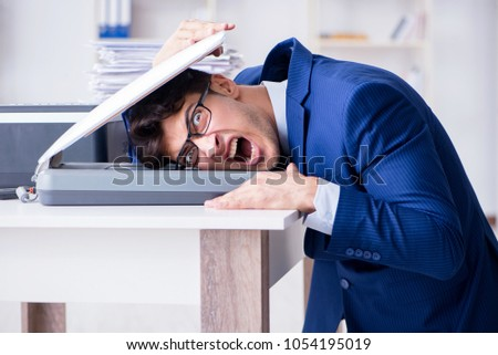 Businessman making copies in copying machine #1054195019