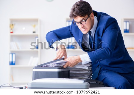 Businessman making copies in copying machine #1079692421