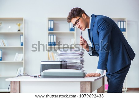 Businessman making copies in copying machine #1079692433