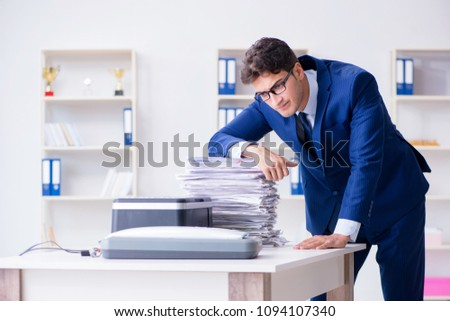 Businessman making copies in copying machine #1094107340