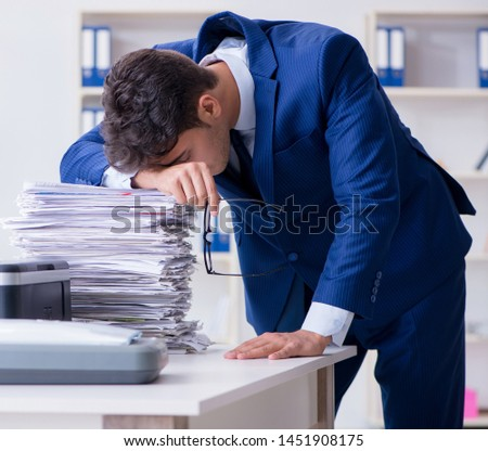 Businessman making copies in copying machine #1451908175