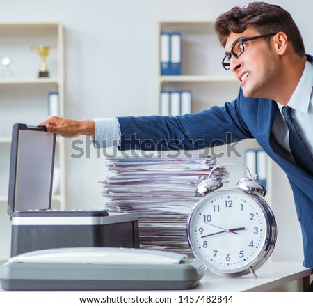 Businessman making copies in copying machine #1457482844