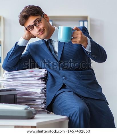 Businessman making copies in copying machine #1457482853