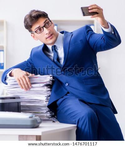 Businessman making copies in copying machine #1476701117
