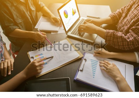 Businessman making presentation with his colleagues and business strategy  in office with graphs and charts being demonstrated on laptop,Pie Graph Analysis Statistics Report Concept,vintage color