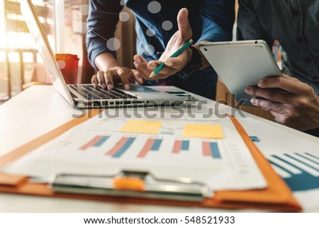 Businessman making presentation with his colleagues and business tablet digital computer at the office as concept in morning light #548521933
