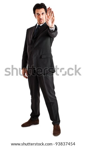 Businessman making stop sign full length