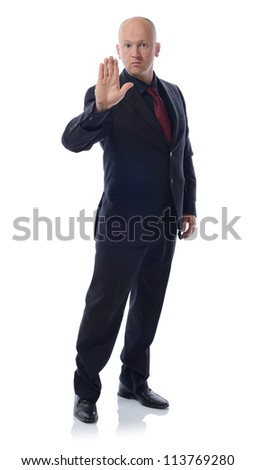 Businessman making stop sign full length isolated on white