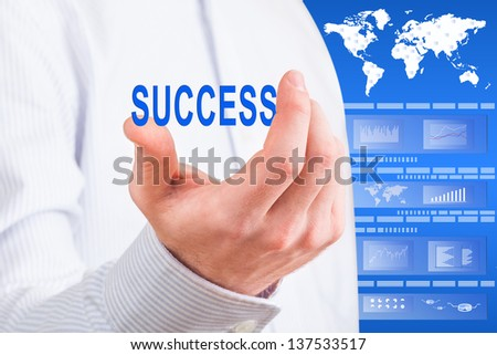 Businessman man hand showing success word against a futuristic display