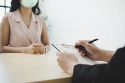 businessman manager and woman wearing protection face during job interview and explaining about his profile in meeting room at office, human resources, business job interview, new normal concept