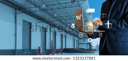 Businessman manager using laptop check orders online goods worldwide for network with Modern Trade warehouse logistics. Industry of logistics network concept.