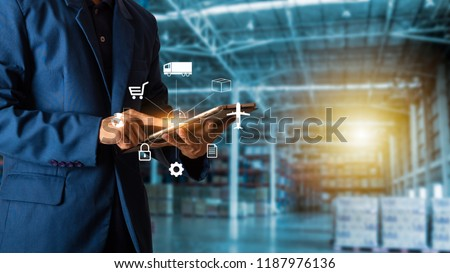 Businessman manager using tablet check and control for workers with Modern Trade warehouse logistics.  and icon of logistics e-commerce.