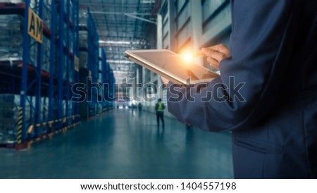 Businessman manager using tablet check and control for workers with Modern Trade warehouse logistics. Industry 4.0 concept #1404557198