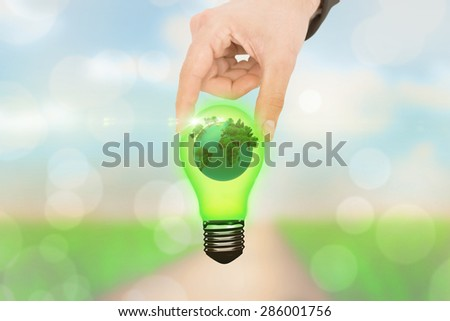 Businessman measuring something with his fingers against yellow abstract light spot design