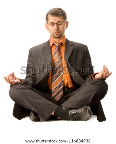 Businessman meditates in lotus position, isolated on  white background