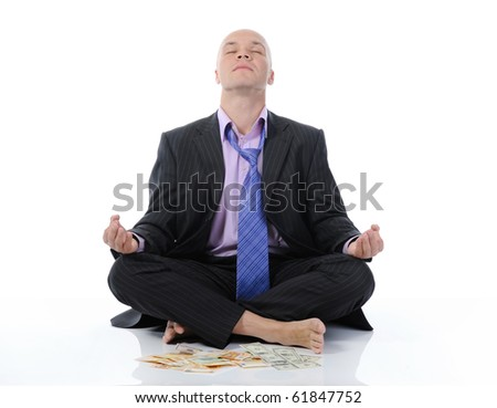 businessman meditating in yoga lotus. Isolated on white background