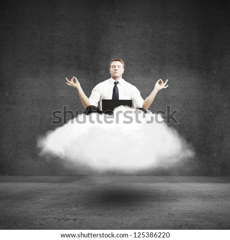 businessman meditating on a cloud in concrete room